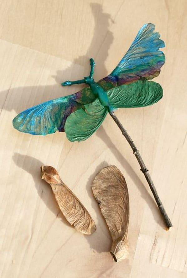 Twig and tree leaf dragon fly