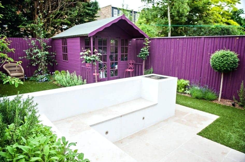 Brightly coloured fence and matching shed