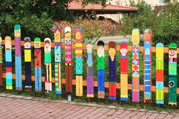 Brightly coloured fence people