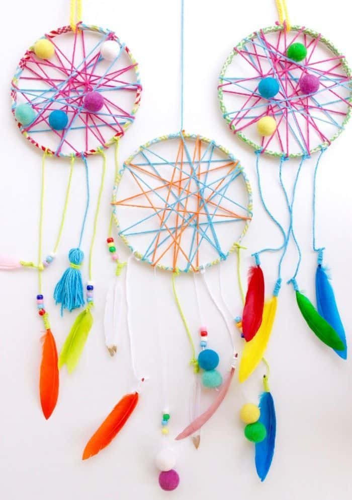Feather, pom pom, and tassel dream catchers