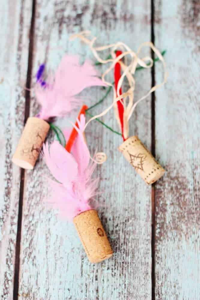 Feathered wine cork toys