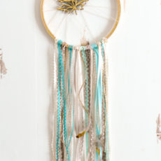 Golden leaf trinket and ribbons dream catcher
