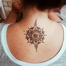 Mandala upper back henna tattoo