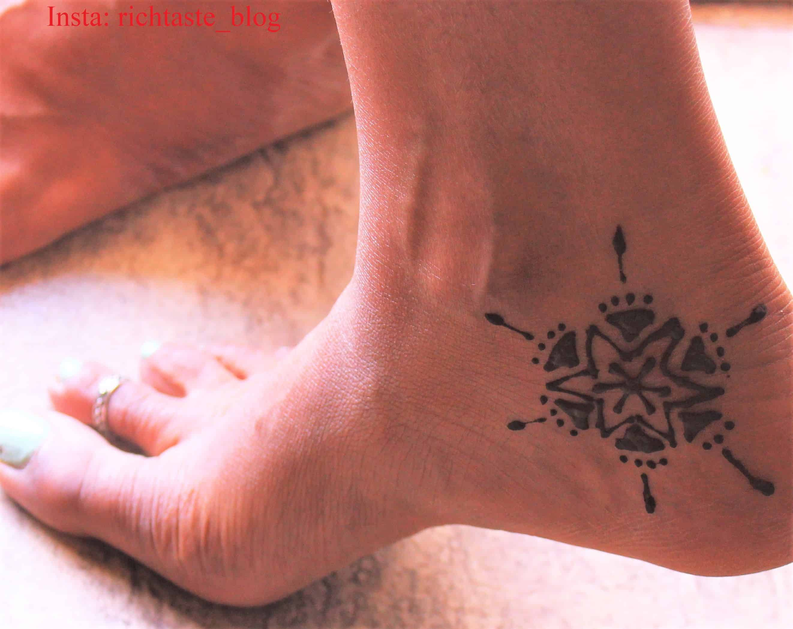 Sunburst inspired inner heel tattoo