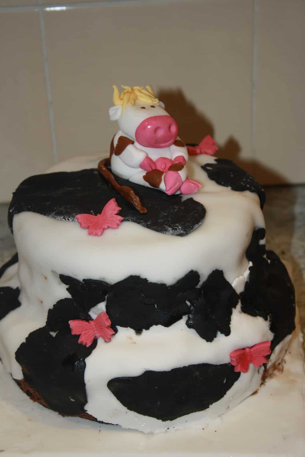Two tiered cow birthday cake