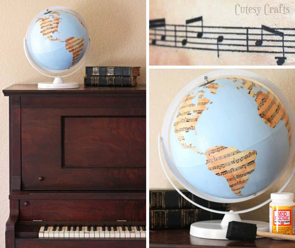 Decoupaged sheet music globe