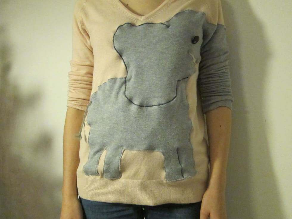 Elephant sweater with a trunk sleeve