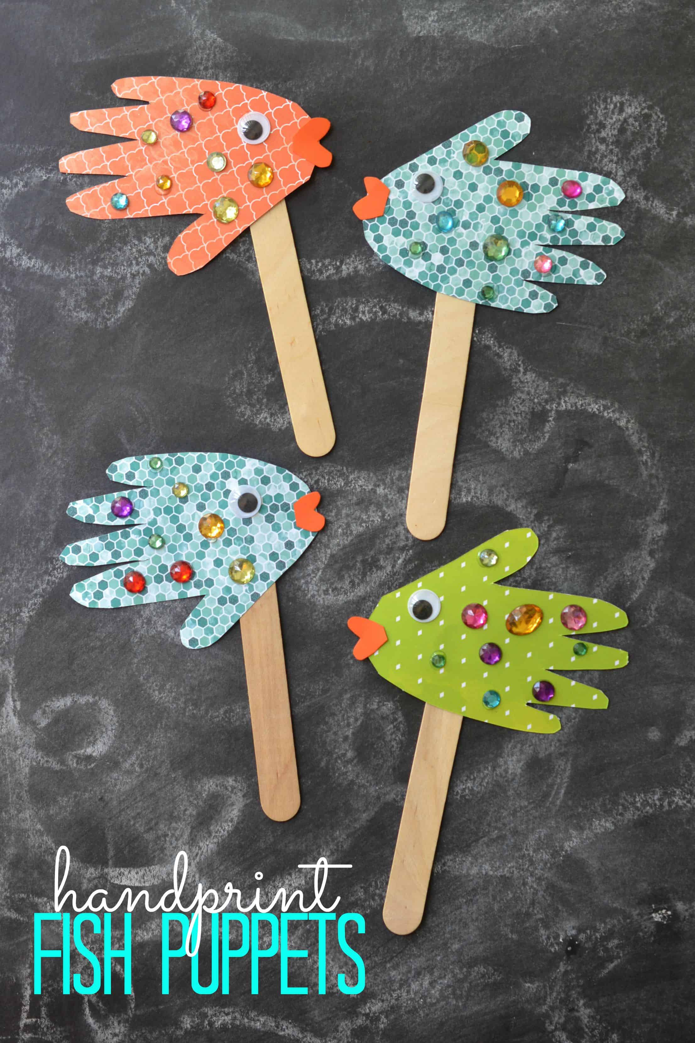 Handprint and crafting stick fish puppets