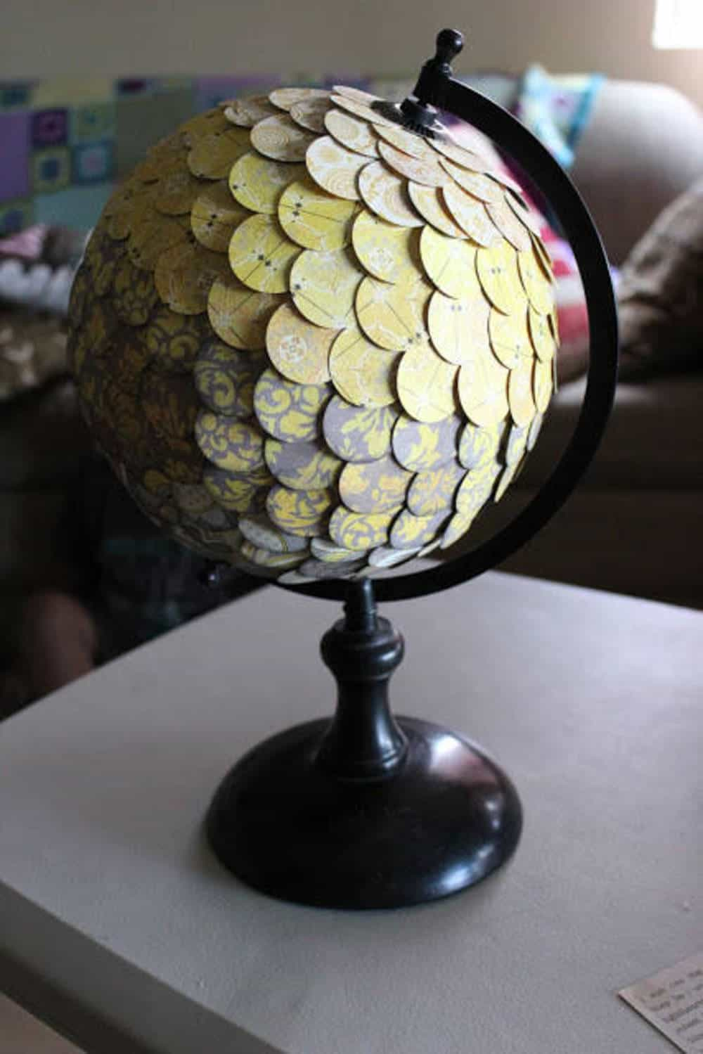 Layered, patterned cut out circles globe