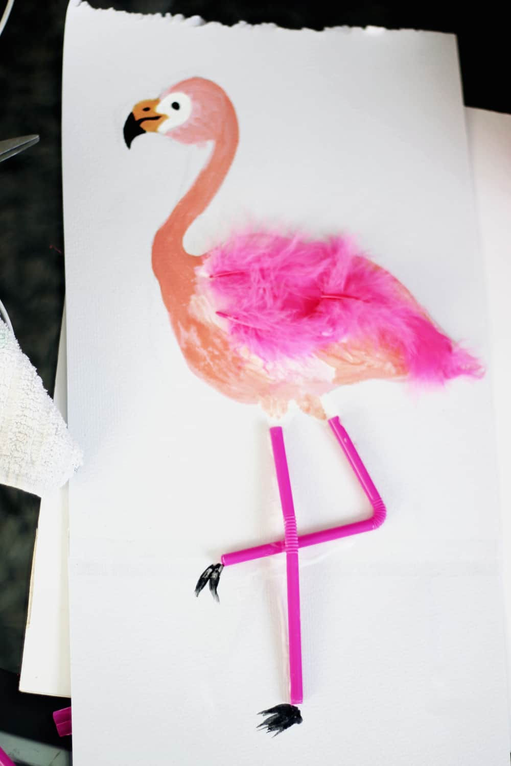 Paint, feather, and straw flamingos