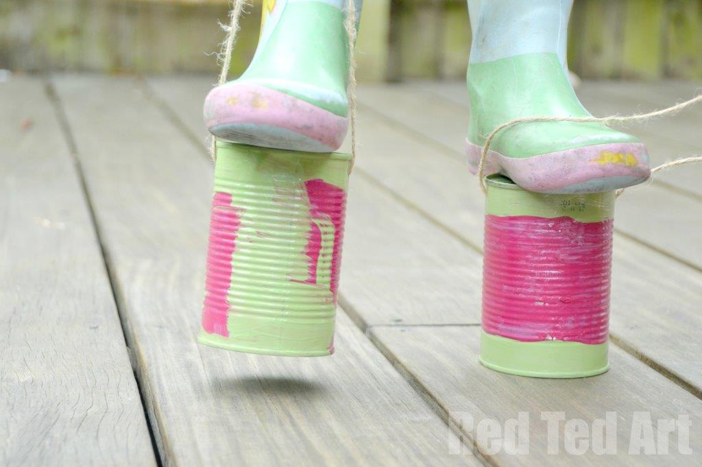 Painted tin can stilts