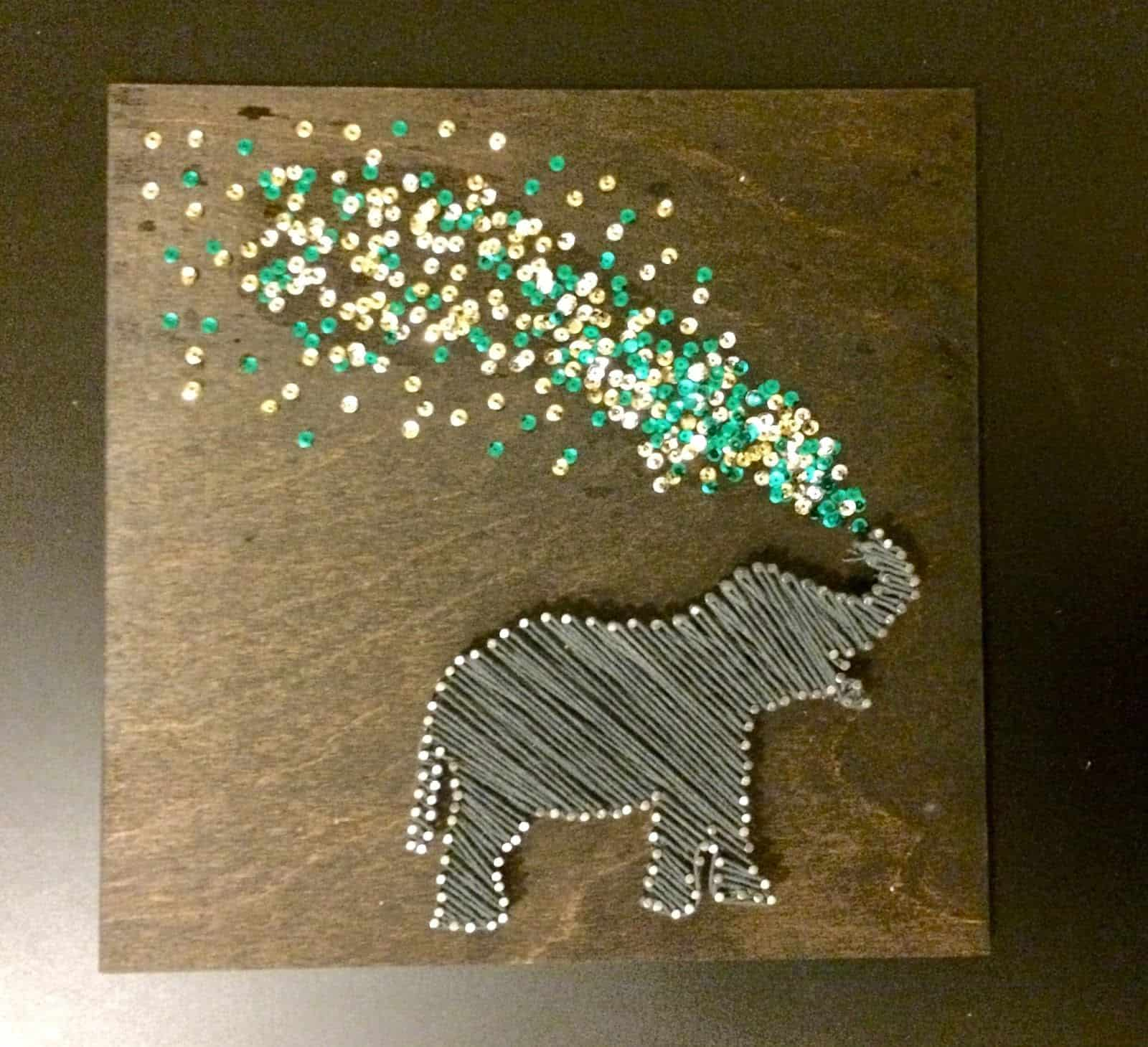 Spraying elephant string art