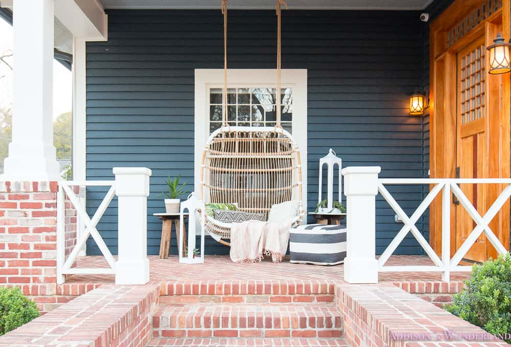 Ecclectic porch swing decor