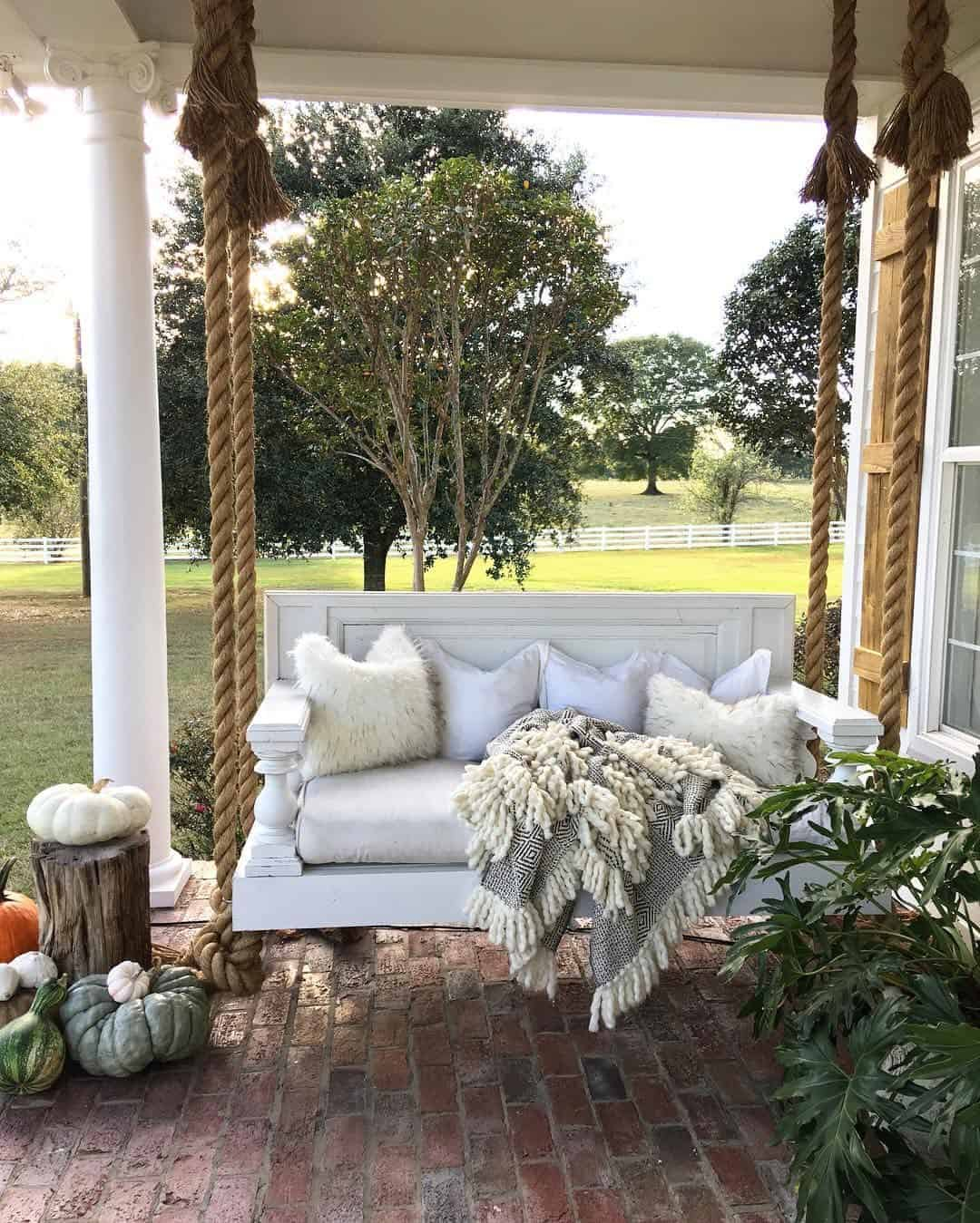 Rustic white back porch swing