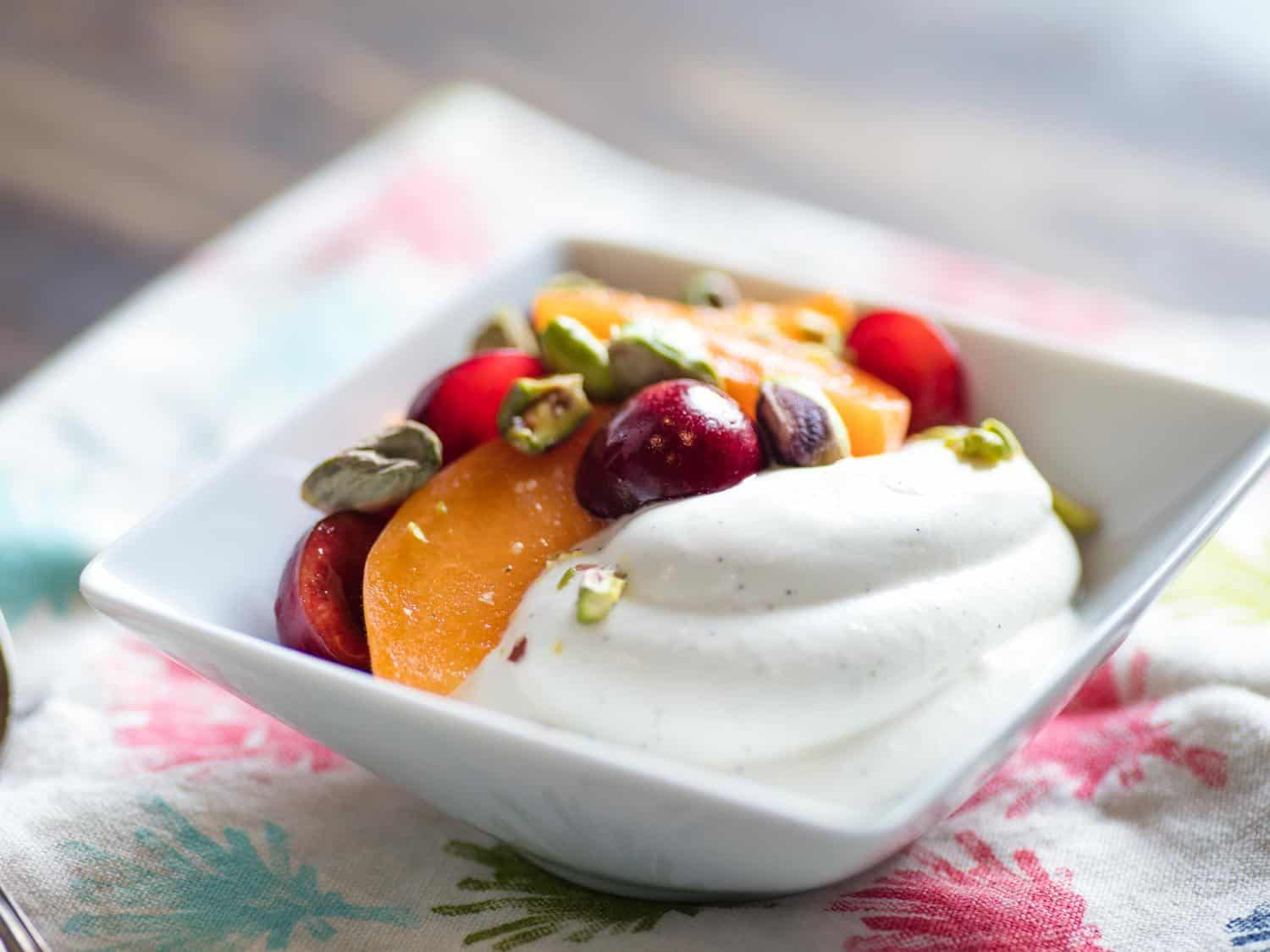 Creamy whipped greek yogurt with fruits and nuts