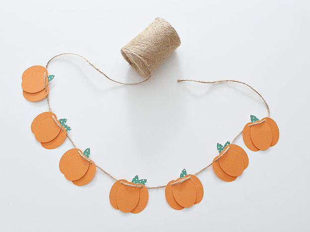 Layered pumpkin and string paper bunting