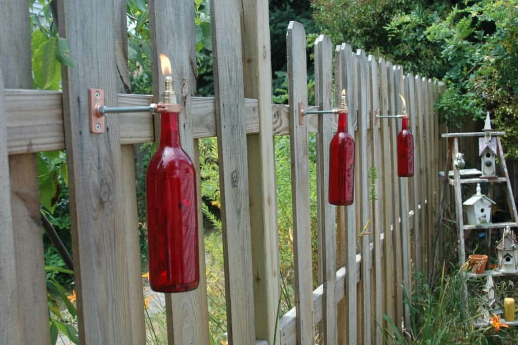 Mounted bottle fence torches