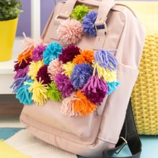 Rainbow yarn pom pom backpack