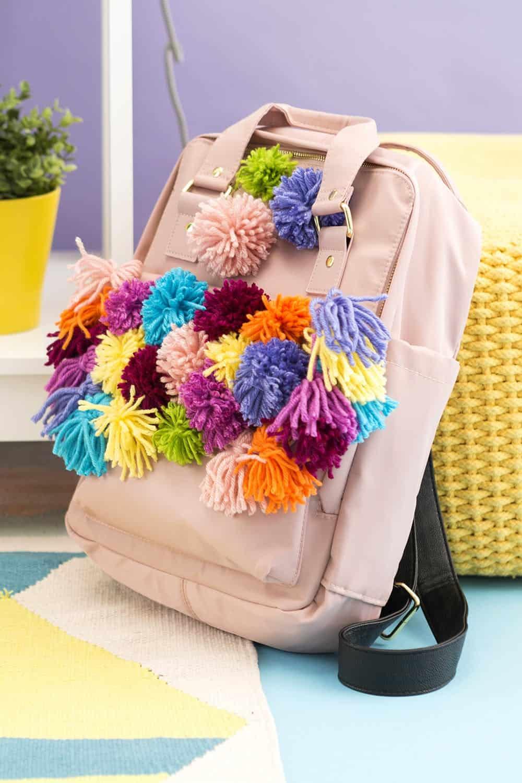 Rainbow yarn pom pom backpack