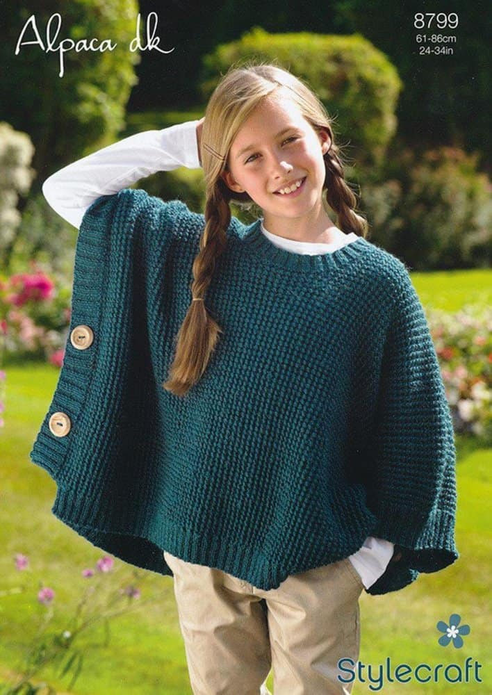 Twisted stitch poncho with side buttons