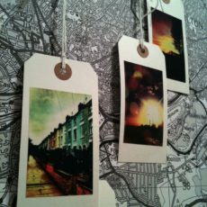 Vintage luggage tag photo wall