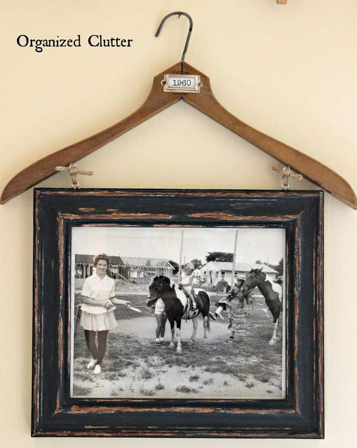 Weathered frame and vintage coat hanger photo