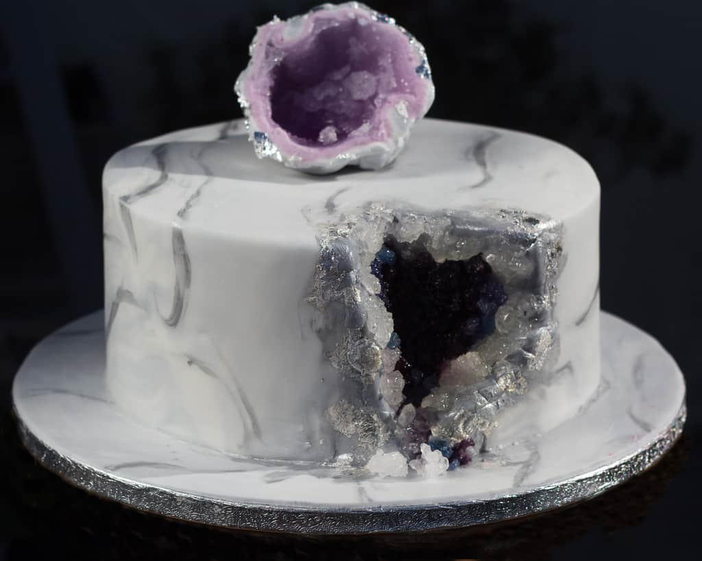 Amethyst geode cake with a gorgeous topper