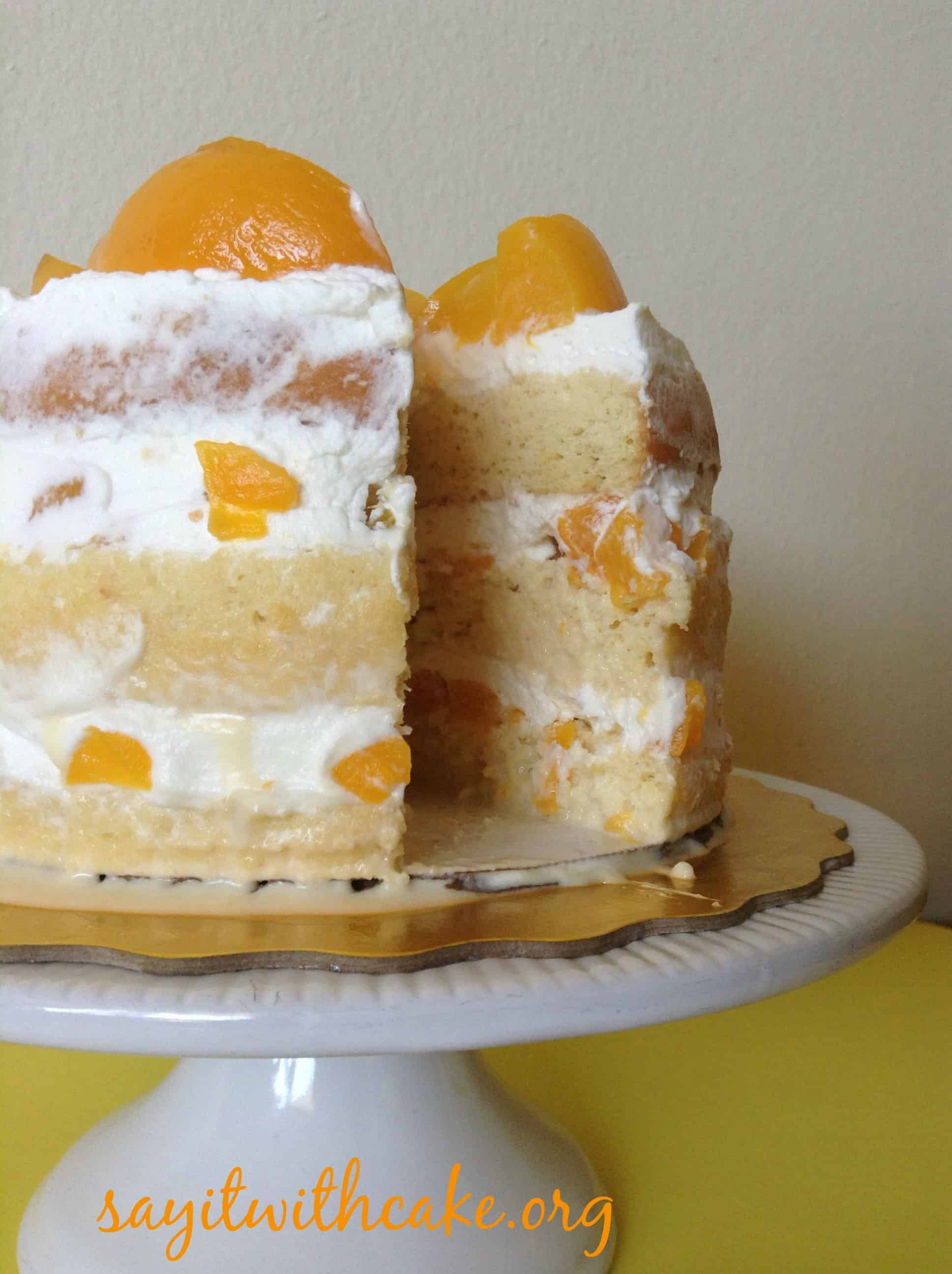 Lyered tres leches cake with peaches and cream filling