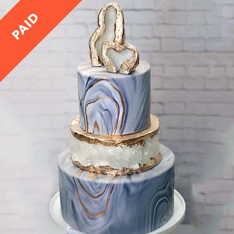 Metallic marbled cake with a grode topper and fully geode layer