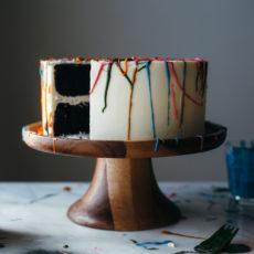 Rainbow chocolate paint splatter cake