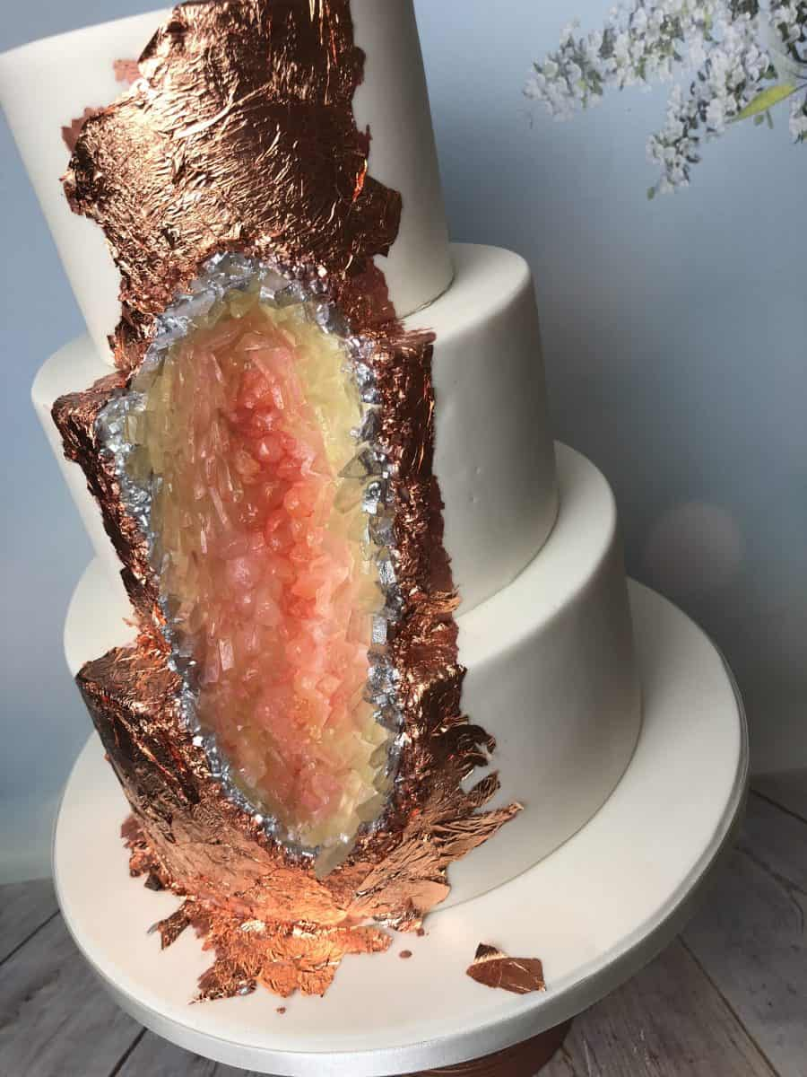 Rose gold and peach tones geode cake
