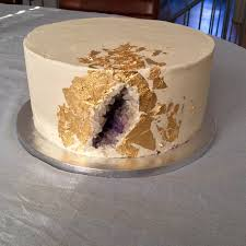 Simple single layer geode cake with edible gold foil
