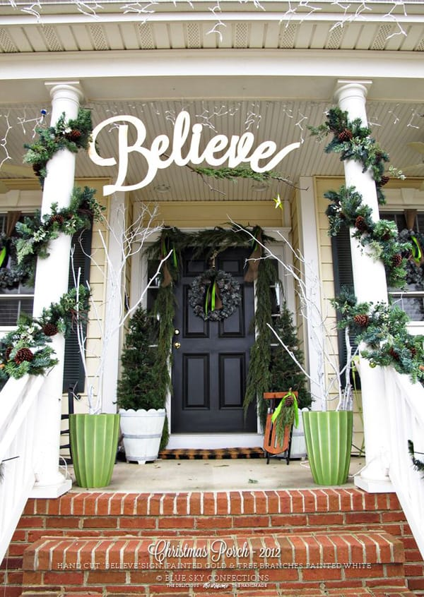 Christmas porch decorating ideas with believe sign