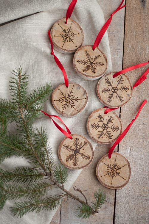 Etched snowflake birch ornaments
