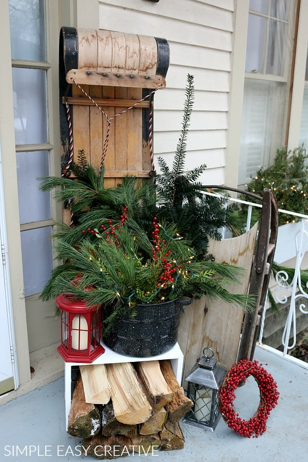 Front porch christmas decorating with sled