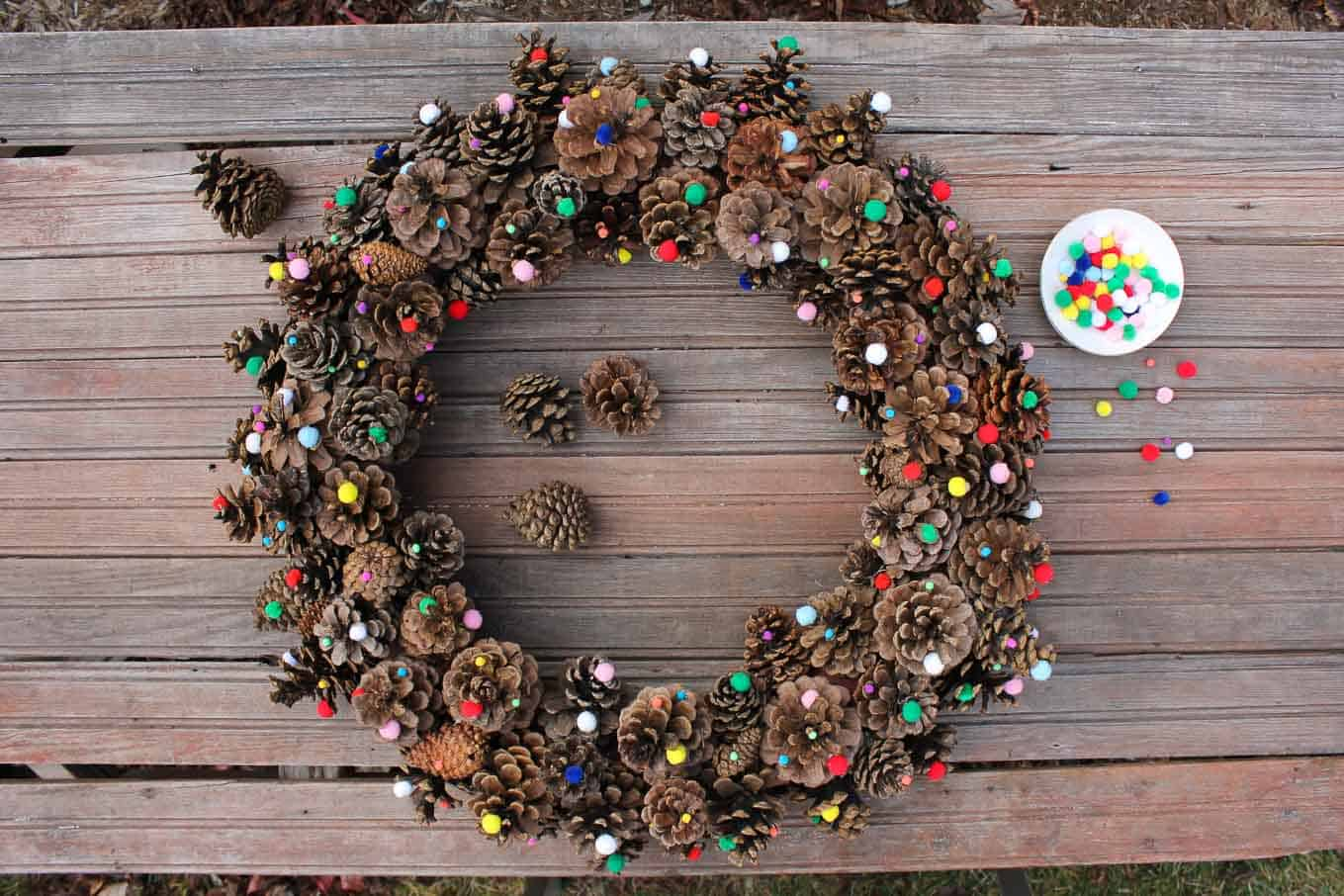 Pine cone and mini pom pom door wreath