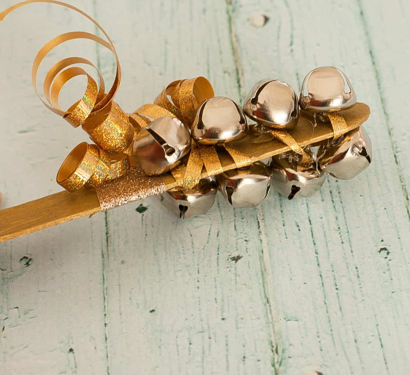 Popsicle stick and bells noisemaker