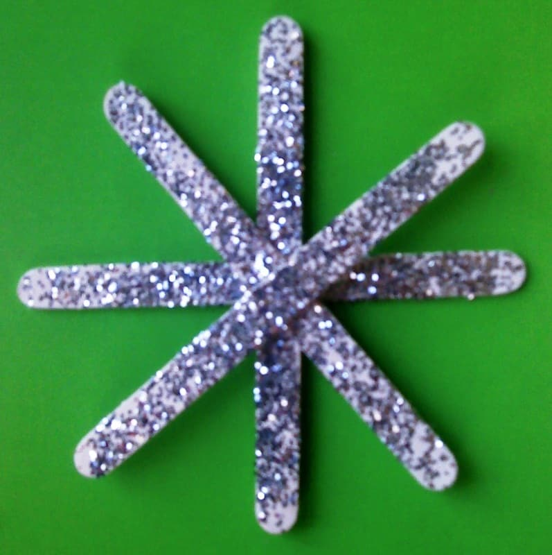Popsicle stick and glitter snowflakes