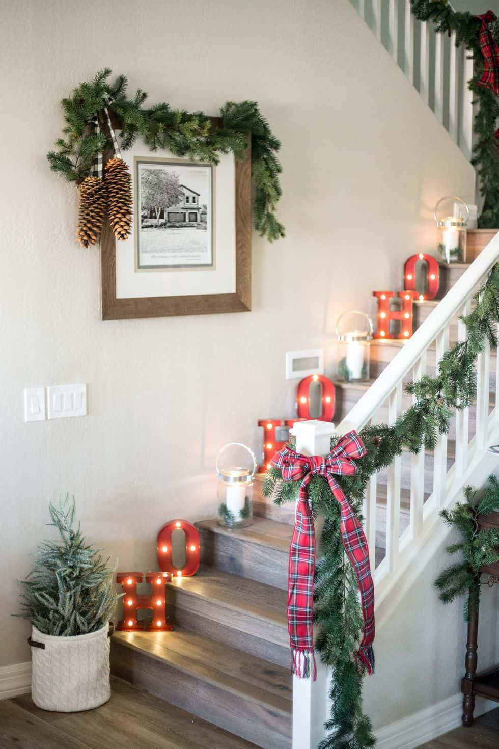 Christmas wall decor with art and garland