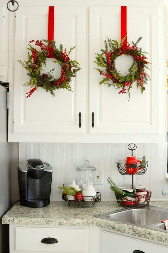 Christmas wreaths and red ribbon in the kitchen