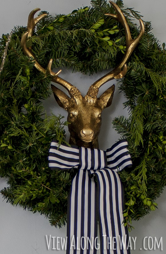 Golden reindeer in a wreath