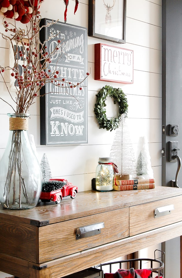Red accented christmas gallery wall