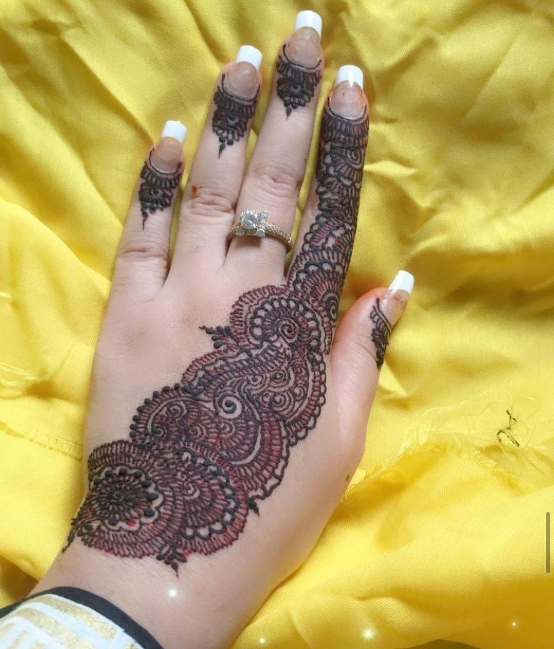 Red & Black Henna Hand Tattoo