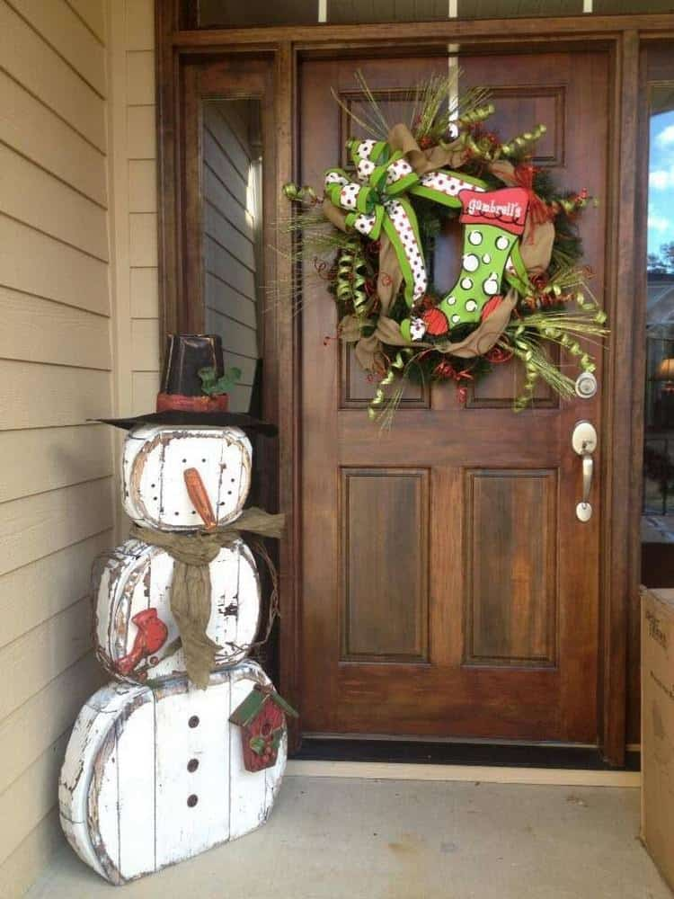 Rustic wooden snowman porch