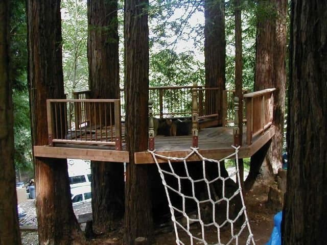 Deck style treehouse with knotted rope ladder