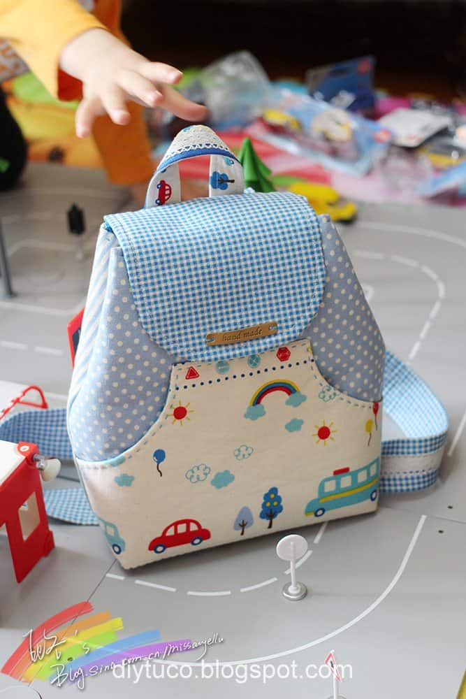 Fabric fla[ backpack with a pocket