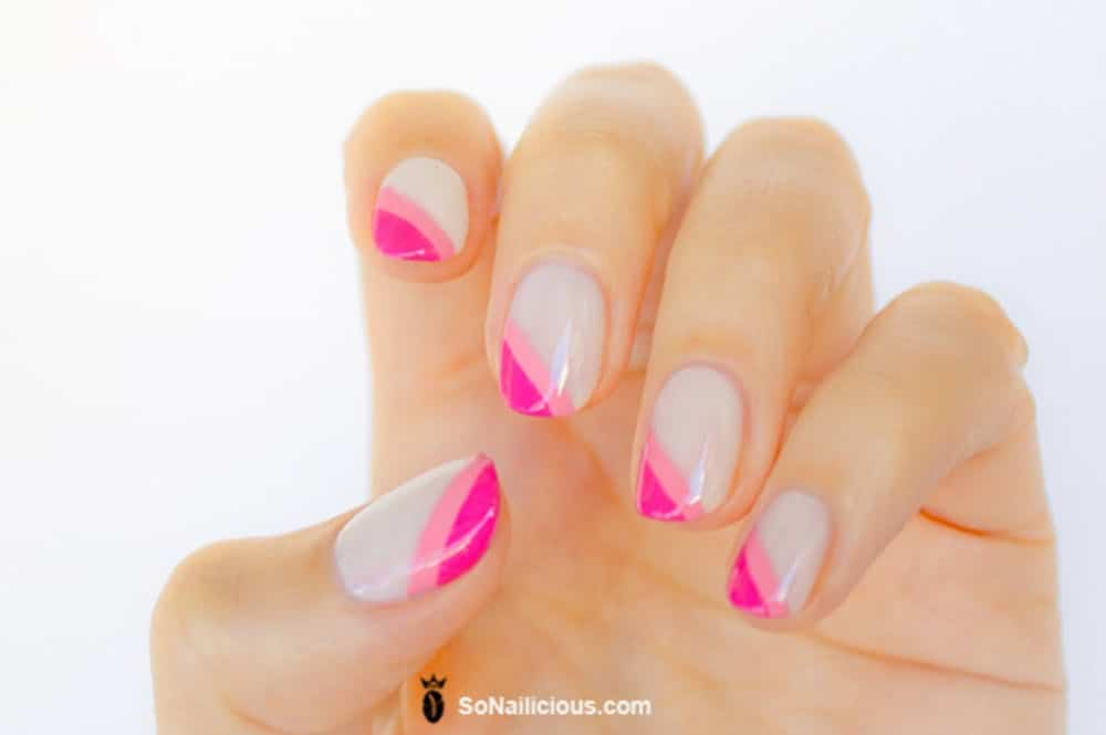 Pink diagnol french tip nail