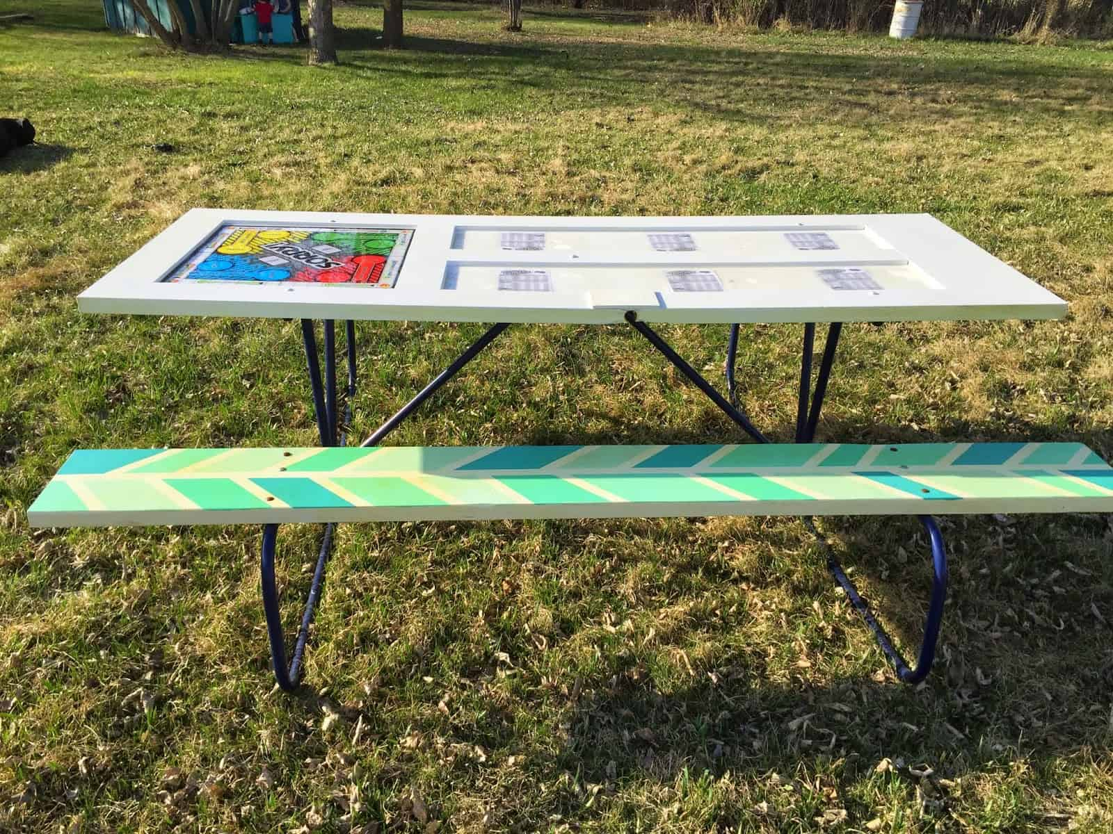 Upcycled door picnic table with a built in board game