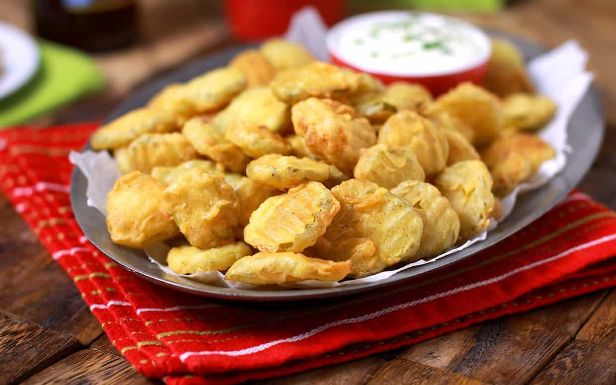 Basic fried pickles with panko crumbs and salt and pepper sliced pickles