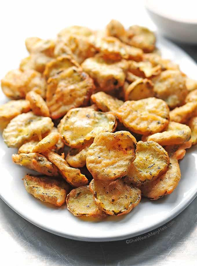Fried pickles with italian seasoning and hot sauce
